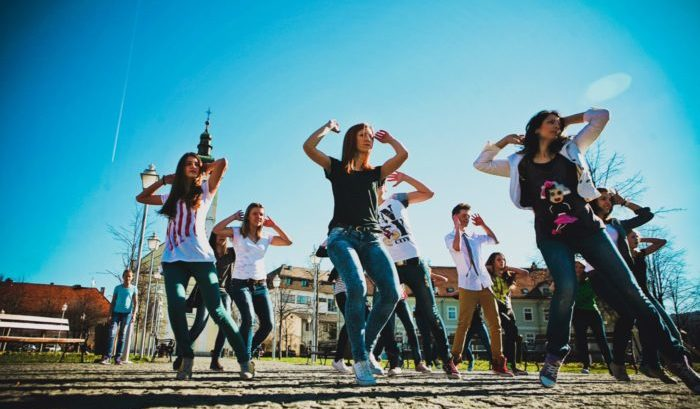 Teenagers dancing on the street dance flashmob